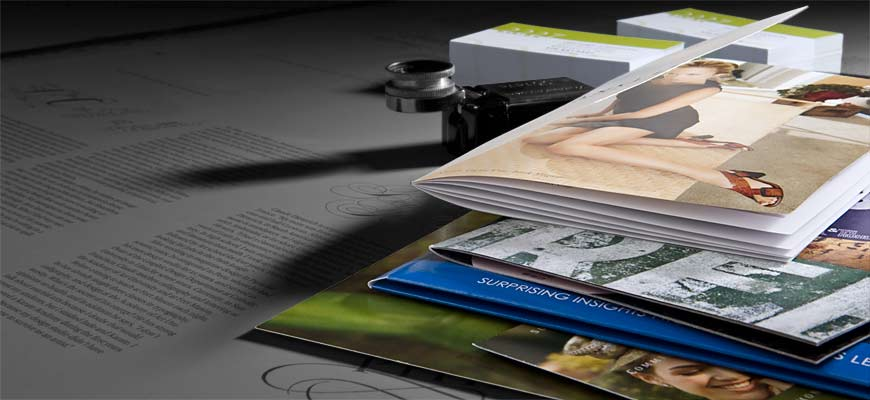 Assortment of printed samples from 4 color brochures to business cards